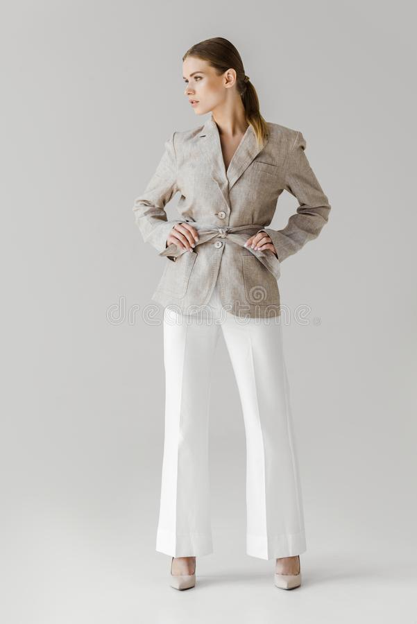 Fashionable young woman in vintage clothes. On white royalty free stock photos
