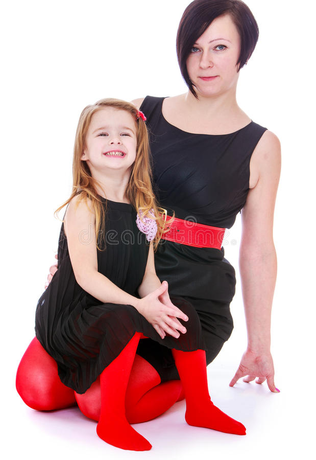 Fashionably dressed mother and daughter stock image