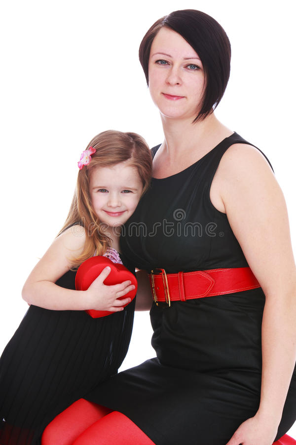Fashionably dressed mother and daughter stock photo