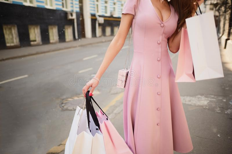 Fashionably dressed woman on the streets of a small town, shopping concept stock photo