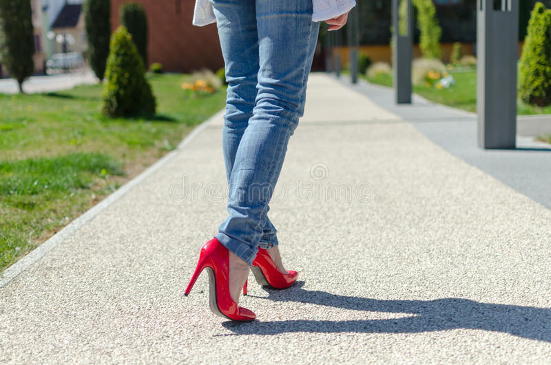 Fashioned woman walking in park royalty free stock photo