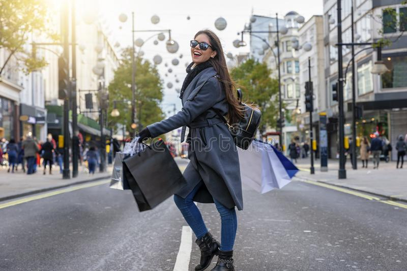 Fashionista woman on a shopping tour at the Oxford Street in London royalty free stock images