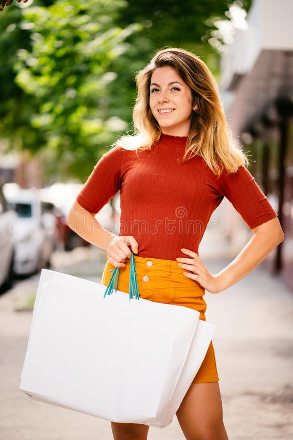 Fashionista woman hold shopping bags, shopping day royalty free stock photos