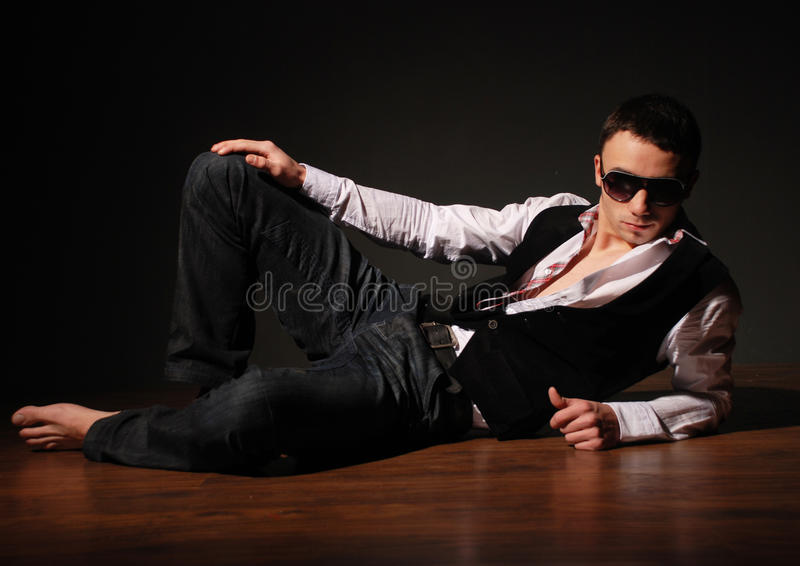 Fashon teenager. Young fashion man model with athletic body posing in sun glasses stock photos