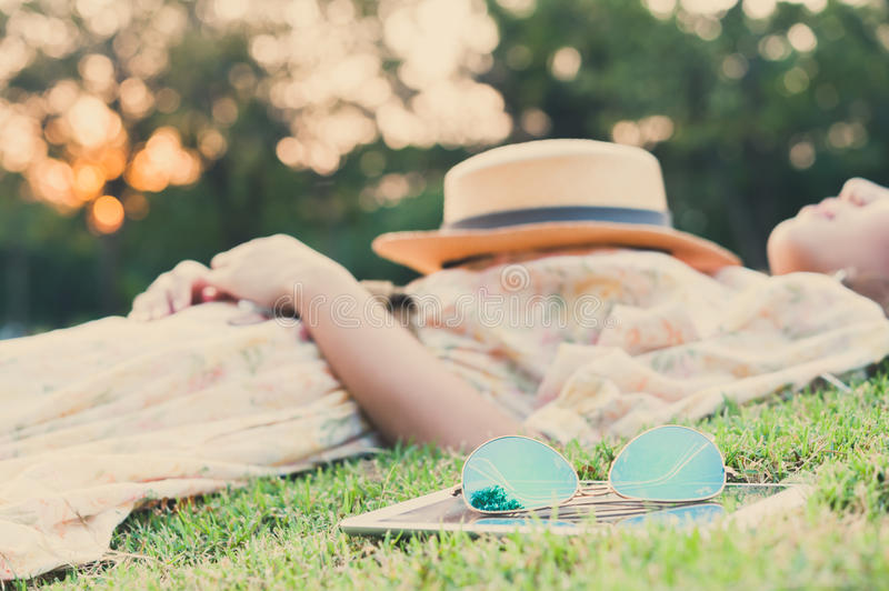 Fasion sun glasses with young woman sleeping , vintage style. Fasion sun glasses with young woman sleeping in background, vintage style stock photography