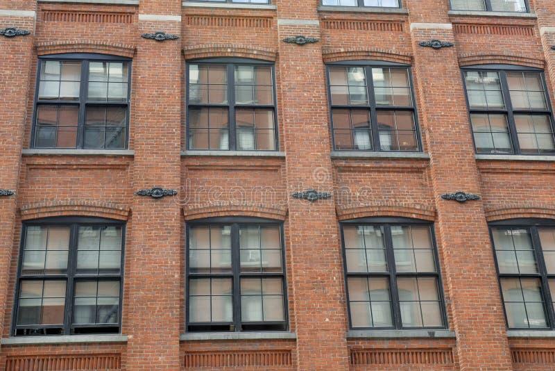 Fassade des Gebäudes des roten Backsteins stockfotografie