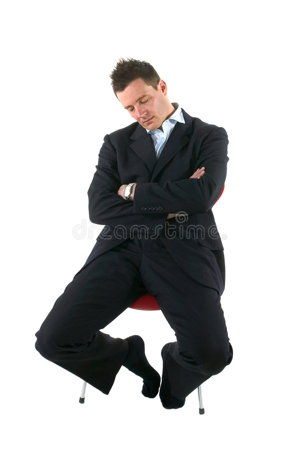 Fast asleep. Businessman asleep on a chair, isolated on white. Who hasn't done this in a meeting