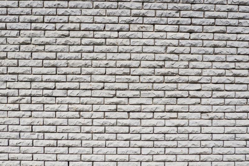 Fast bakgrundstegelstenvägg royaltyfri bild