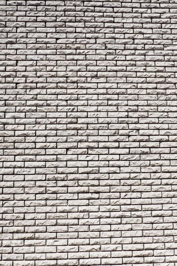 Fast bakgrundstegelstenvägg royaltyfria foton