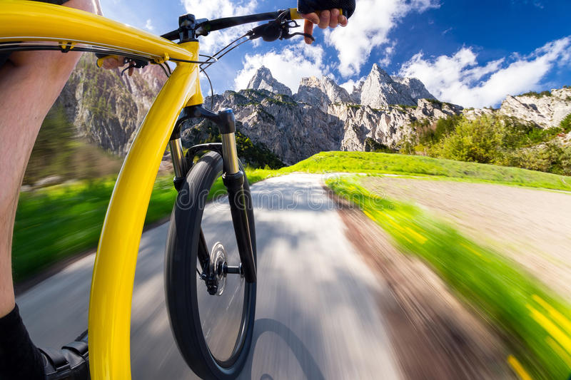 Fast bicycle front view. Of fast dynamic bicycle with mountain landscape royalty free stock image