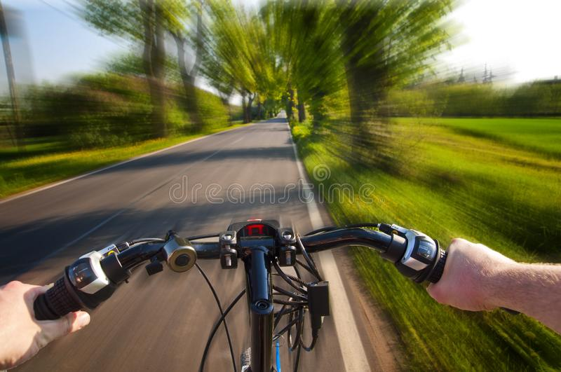 Fast bike ride - point of view perspective stock images