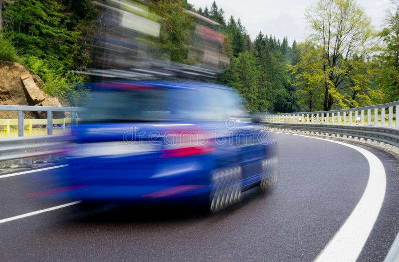 Fast blue car on a twisty road royalty free stock images