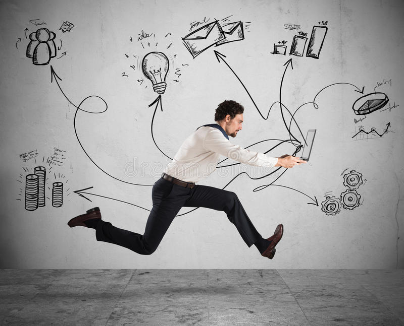 Fast business. Concept with businessman running with a laptop royalty free stock photo
