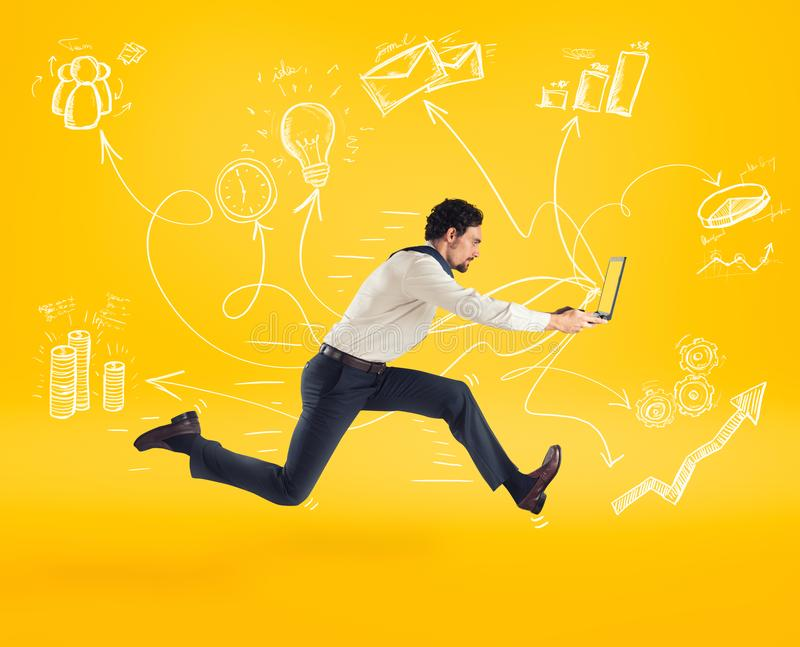 Fast business concept with businessman running with a laptop. Yellow background. Fast business concept with businessman running with a laptop royalty free stock images