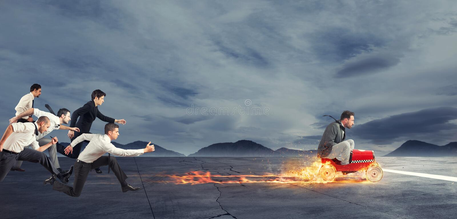 Fast businessman with a car wins against the competitors. Concept of success and competition stock image