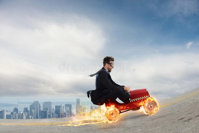 Fast businessman with a car wins against the competitors. Concept of success and competition royalty free stock photography