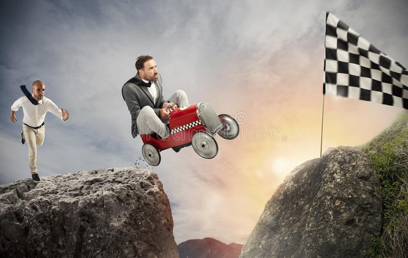 Fast businessman with a car wins against the competitors. Concept of success and competition royalty free stock images