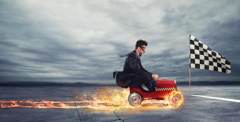 Fast businessman with a car wins against the competitors. Concept of success and competition stock photography