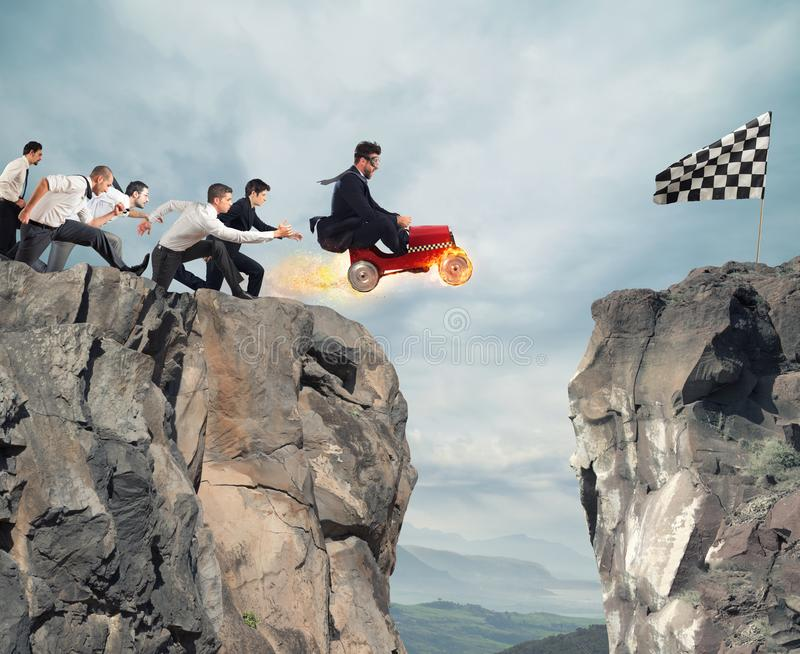 Fast businessman with a car wins against the competitors. Concept of success and competition stock photos