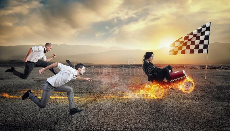 Fast businesswoman with a car wins against the competitors. Concept of success and competition. stock photography