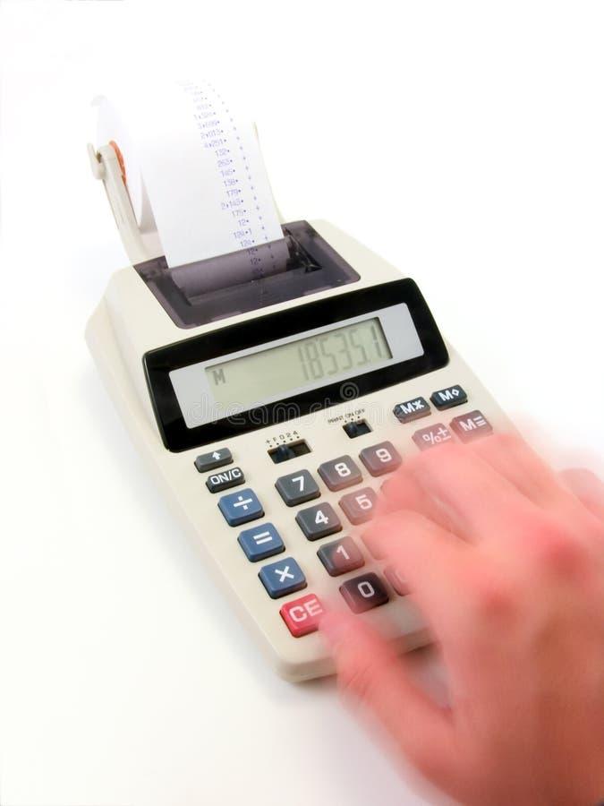 Fast calculations 2. A speedy hand running a calculator very hard. Deep DOF stock images