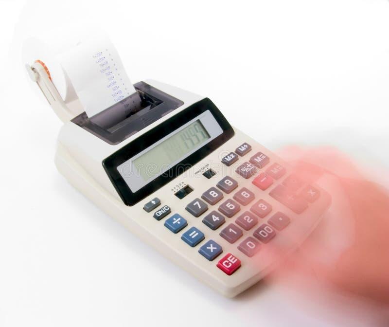 Fast calculations. A speedy hand running a calculator very hard. Deep DOF royalty free stock photos