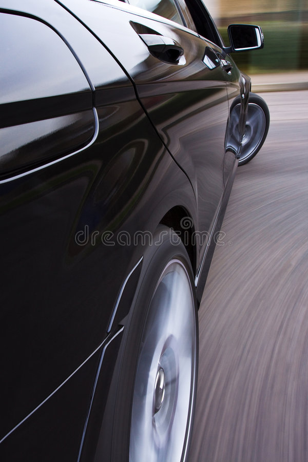 Fast car cornering stock photography