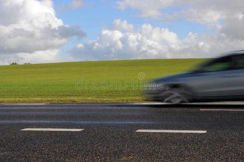Fast car on highway. Fast moving car on highway royalty free stock photo