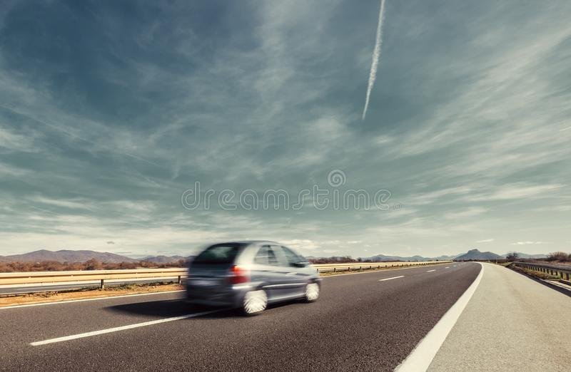 Fast Car Highway motion with wide sky background royalty free stock images
