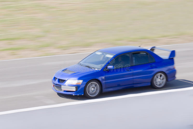 Fast car in a race. Fast blue car in a race royalty free stock images