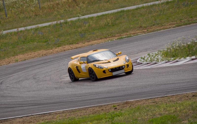 Fast car in a race. Fast yellow car in a race stock images