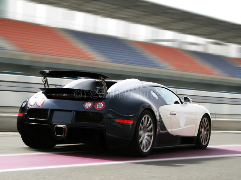 Fast car on track. Fast black and white car on racetrack