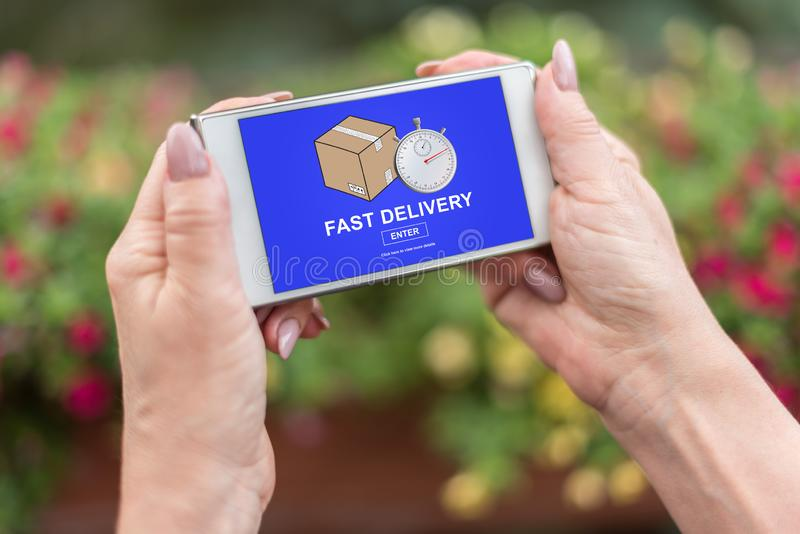 Fast delivery concept on a smartphone stock image