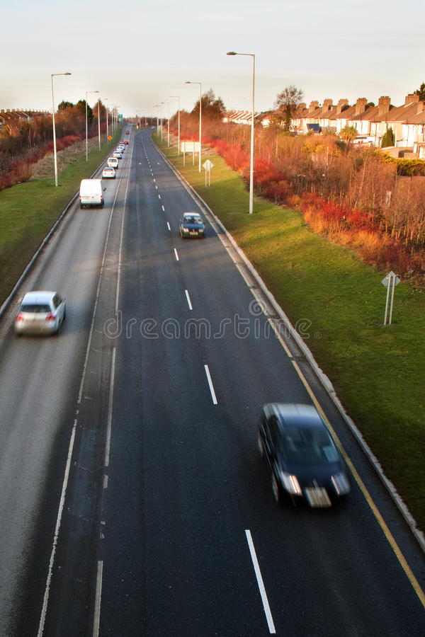 Fast driving cars on road royalty free stock photography