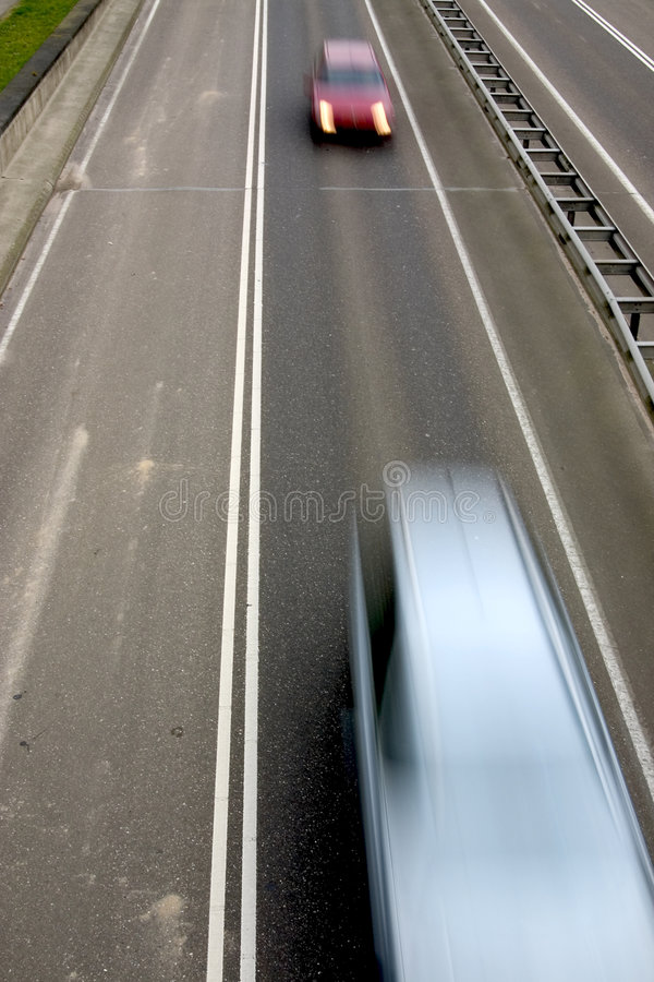 Fast Driving Cars On The Road Stock Images