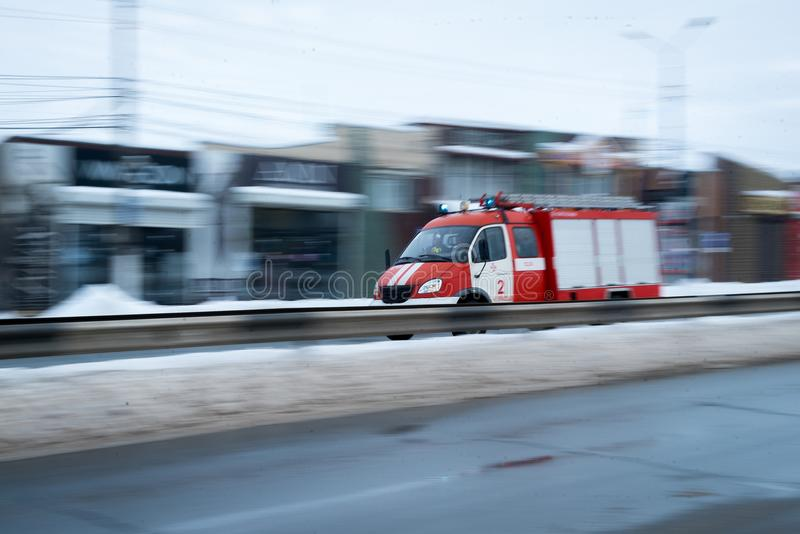 Fast driving fire truck in a city royalty free stock images