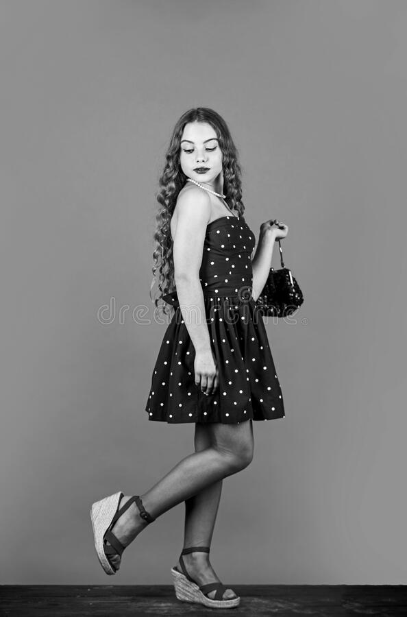 Fast fashion essentially business model companies that manufacture products. Retro fashion. Movement towards vintage. Fashion. Little girl makeup face curly royalty free stock photo