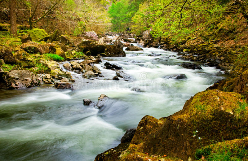Fast flowing river. In welsh valley royalty free stock photography