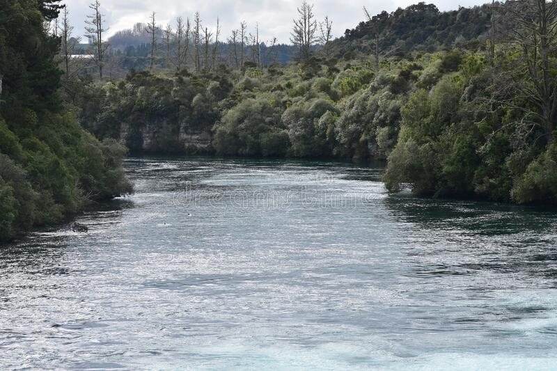 Fast flowing Waikato River after Huka Falls royalty free stock photography