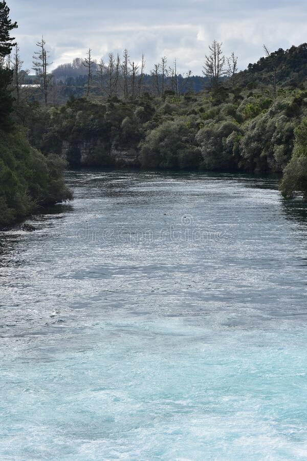 Fast flowing Waikato River at Huka Falls royalty free stock photos