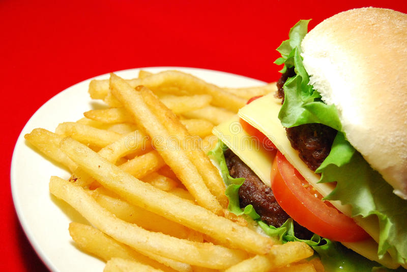Fast food. Cheeseburger and french fries menu on red background royalty free stock photos