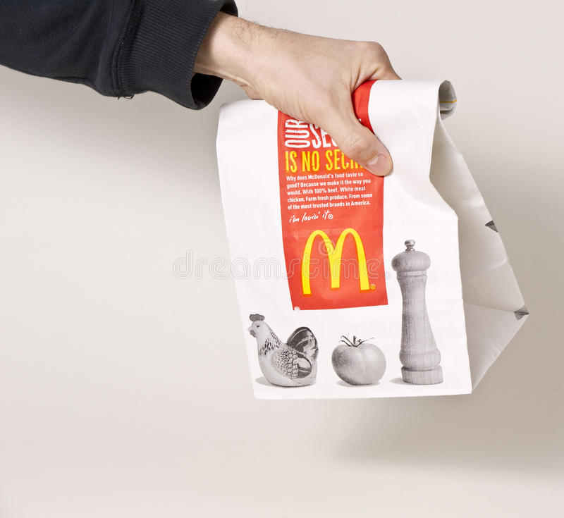 Fast Food. Picking up a bag full of fast food from McDonald's restaurant royalty free stock photos