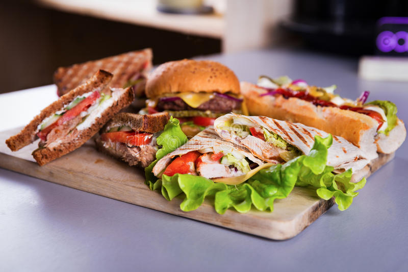 Fast food burger hot dog sandwich chicken wrap stock images