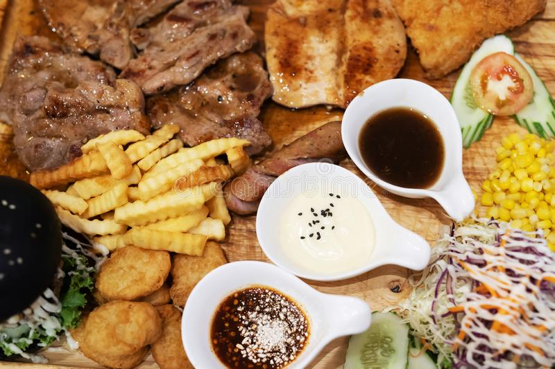 Fast food concept with greasy grill fried restaurant take out as Succulent thick juicy portions of grilled fillet steak served, bu stock photos