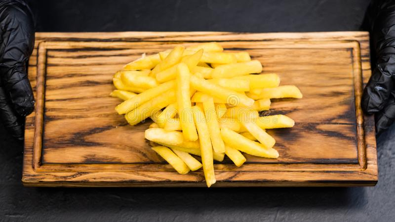 Fast food dish salted french fries wooden board royalty free stock photography