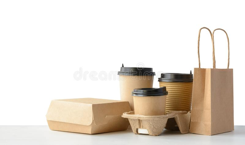 Fast food and drink packaging set isolated on white. Fast food packaging set. Paper coffee cups in holder, food box, brown paper bag isolated over white royalty free stock image
