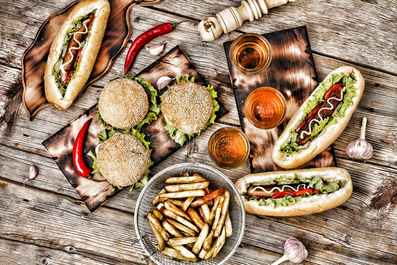 Fast-Food, Food Festival. Food Buffet Catering Dining Eating Party Sharing Concept. Food Festival. All kinds of fast food. hot dog royalty free stock images