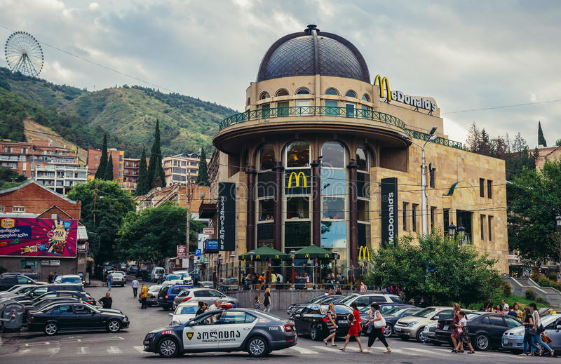 Fast food in Georgia. Tbilisi, Georgia - July 18, 2015. Police car drives in front of McDonald's restaurant in Tbilisi stock photo