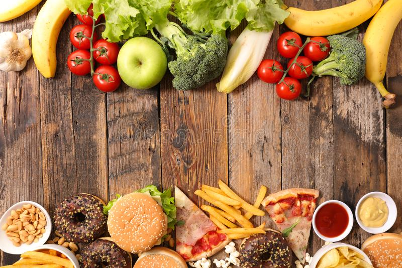 Fast food or health food. On wood royalty free stock images