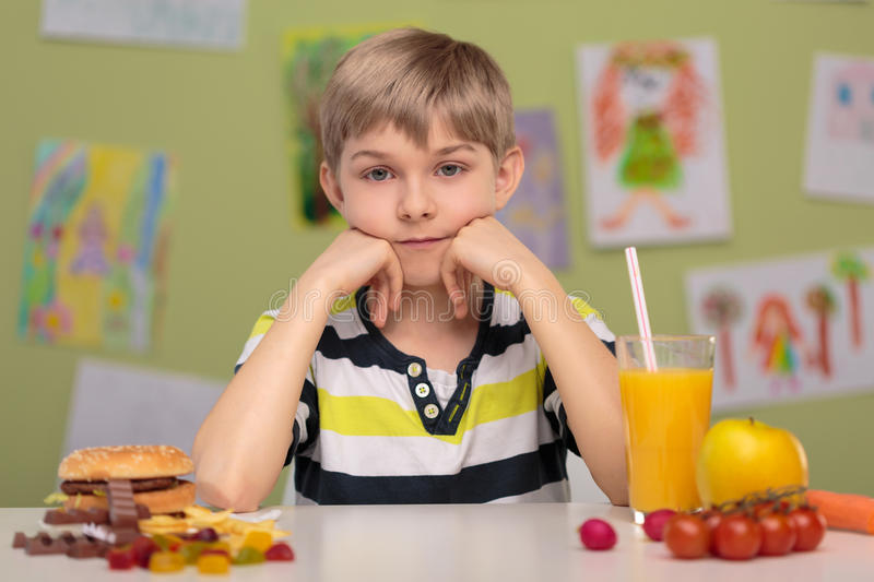 Fast food or healthy food. Hard decision - fast food or healthy food royalty free stock images